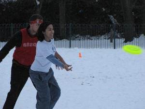 Chapala throws a forehand up the line - men and women play together in Ultimate Frisbee